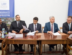 signing an agreement on cooperation with the representatives of Centre Al-Sulaiteen